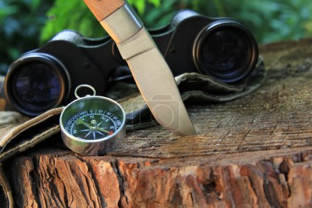 Photo for Survival tools on wood . Knife , compass and binocular - Royalty Free Image