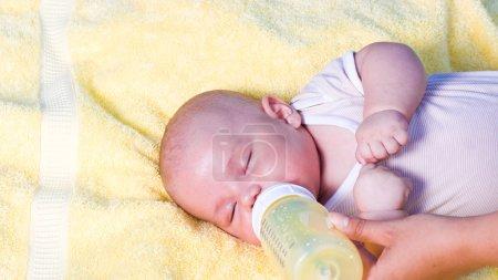 Baby boy drinking milk from bottle
