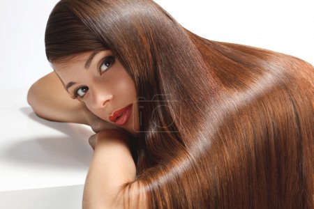 Portrait of Beautiful Woman with smooth gloss long...