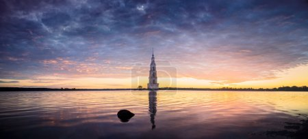 Place for meditation on morning river with flooded Church in Kalayzin