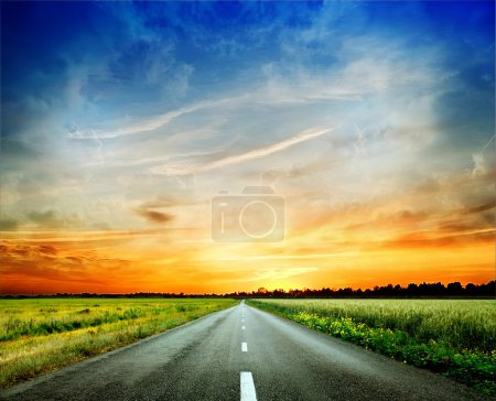 Photo for Sunset over blurred asphalt road - Royalty Free Image