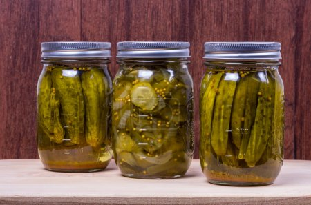 Photo for Three different jars of pickled cucumbers - Royalty Free Image