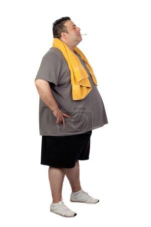 Fat man playing sport and smoking
