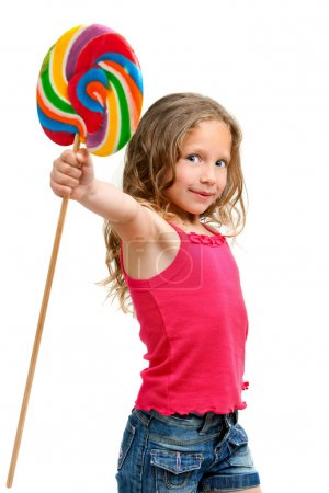 Cute girl holding candy stic.