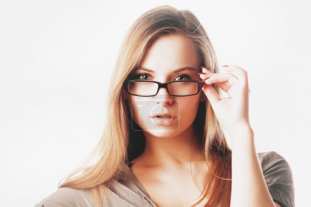 Sexy blonde woman with glasses isolated