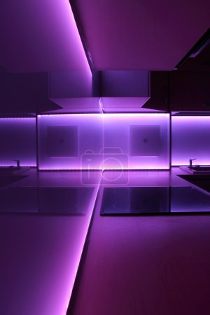 Photo for Modern luxury kitchen with purple led lighting - Royalty Free Image