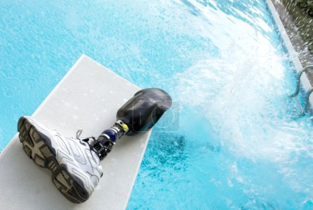 Photo for Prosthetic leg left on diving board. - Royalty Free Image