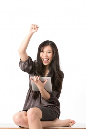 Successful woman with Digital Tablet.