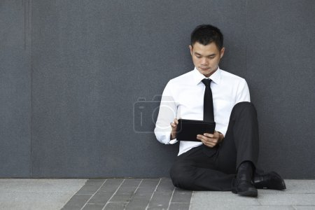 Asian Business man using a Touch-Pad