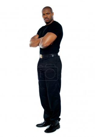 Photo for Male security guard with strong arms crossed on white background - Royalty Free Image