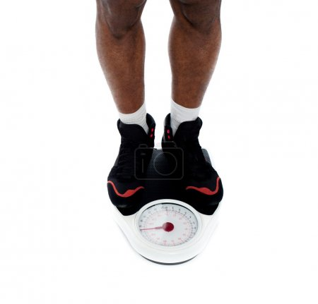 Man's feet on weighing scale