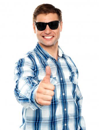 Photo for Smart young guy showing thumbs up over white background - Royalty Free Image