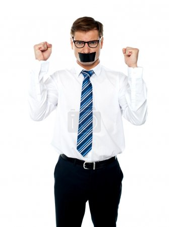 Angry young man with duct tape on his mouth