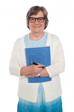 Happy aged woman holding notebook and pen