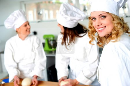 Photo for Group of professional female chefs in commercial kitchen - Royalty Free Image
