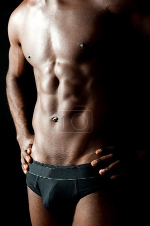 Photo for Shirtless underwear male model posing in style. Hands on waist, cropped image - Royalty Free Image