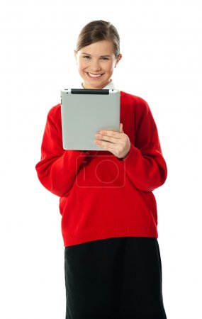 Confident girl using wireless portable device