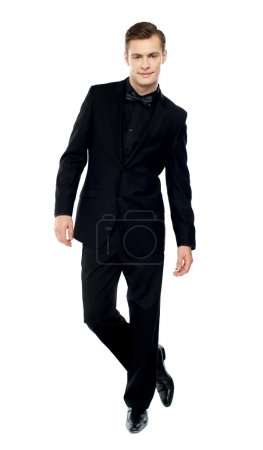 Photo for Isolated young man standing with crossed legs dressed in party wear - Royalty Free Image
