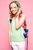 Teenager with backpack listening to music