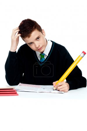 Photo for Confused worried young school boy thinking about homework - Royalty Free Image