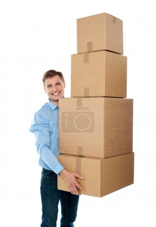 Handsome male with with stack of boxes