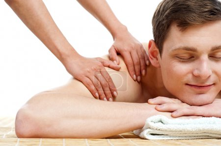 Attractive young man getting spa massage
