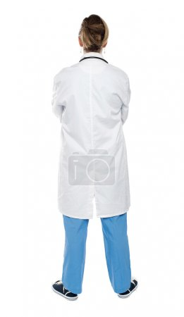 Photo for Back view of a female doctor looking at white. Full length shot - Royalty Free Image