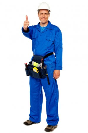 Worker with tools bag showing thumbs up