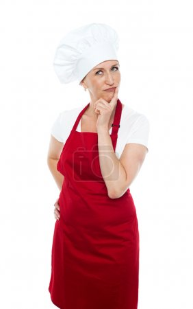 Thoughtful female chef looking away