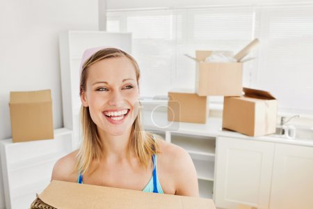 Radiant woman holding boxes