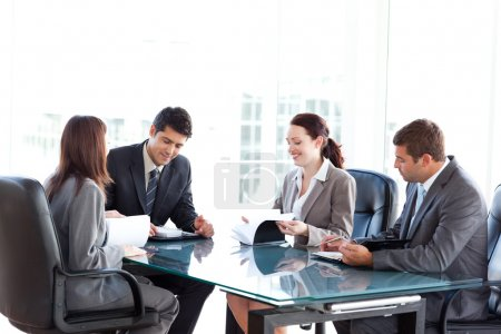 Four business during a meeting