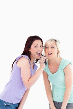 Cheering Women singing karaoke