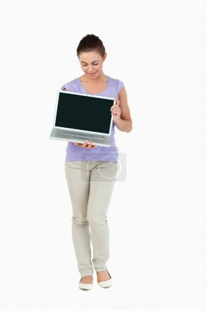 Young female presenting her laptop screen