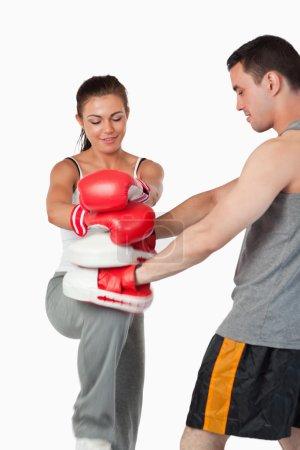 Постер, плакат: Female martial arts fighter practicing her knee technique, холст на подрамнике