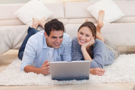 Young couple looking for something on the internet