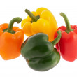 Orange, yellow, red and greeen bell peppers isolat...