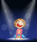 a boy crying on stage
