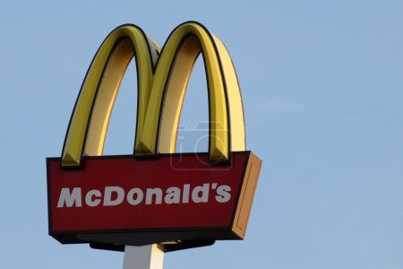 McDonalds sign isolated with blue sky background...