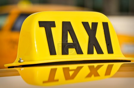 Yellow and Black Taxi Cab Car Sign
