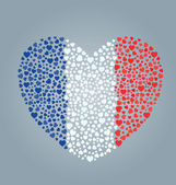Heart created out of a bunch of small hearts and colored like a French flag