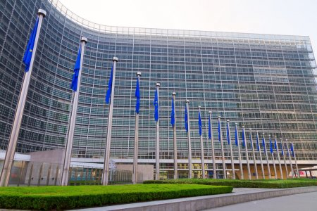 Photo for Side view of European flags in front of the European Commission headquarters in Brussels, Belgium - Royalty Free Image