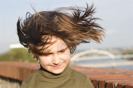 Portrait of little girl in the wind