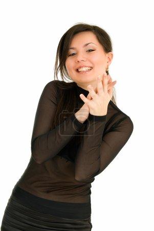 Photo pour Jeune femme montre l'extase à quelque chose sur fond blanc - image libre de droit