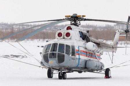 """NORILSK, RUSSIA - MARCH 31: The helicopter """"Mi-8"""" on the Taimyr Peninsula. The helicopter belonging to the Russian Ministry of Emergency Situations is located on the airfield. on March 31, 2"""