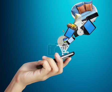 Photo pour Téléphone portable à écran tactile, en main et globes - image libre de droit
