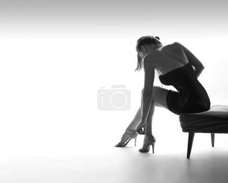 Sexy woman from back, legs, high heel shoes, white background