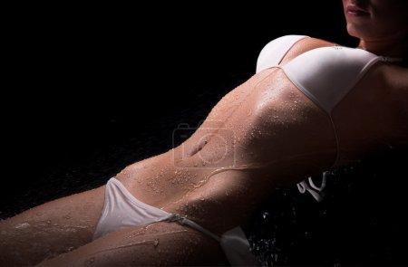 Sexy woman wet body and white bikini