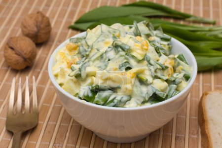 Photo for Salad of ramsons along with the egg and cucumber - Royalty Free Image