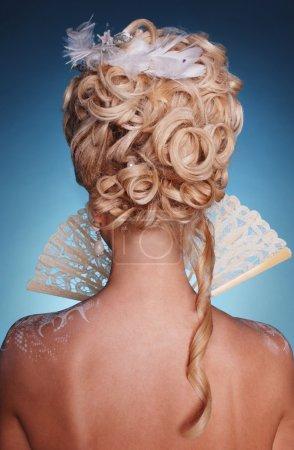 Beautiful blonde girl in romantic style