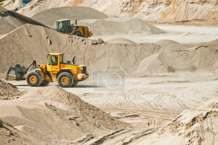 Working machines at gravel pit